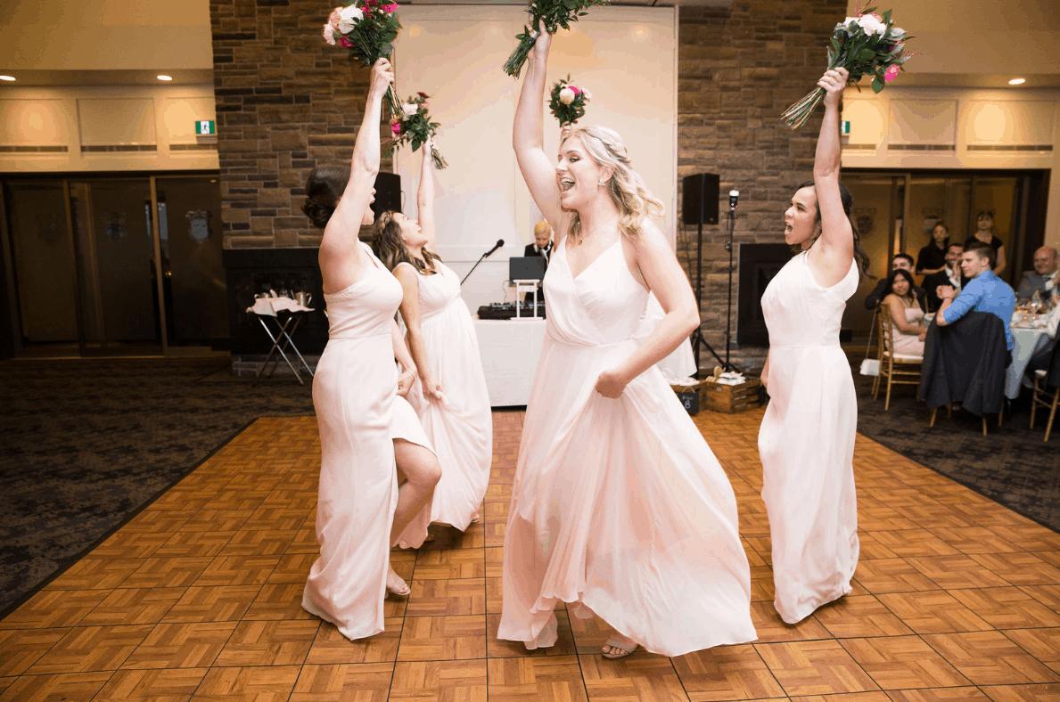 4 bridesmaids dancing at a Credit Valley Golf and Country Club wedding!